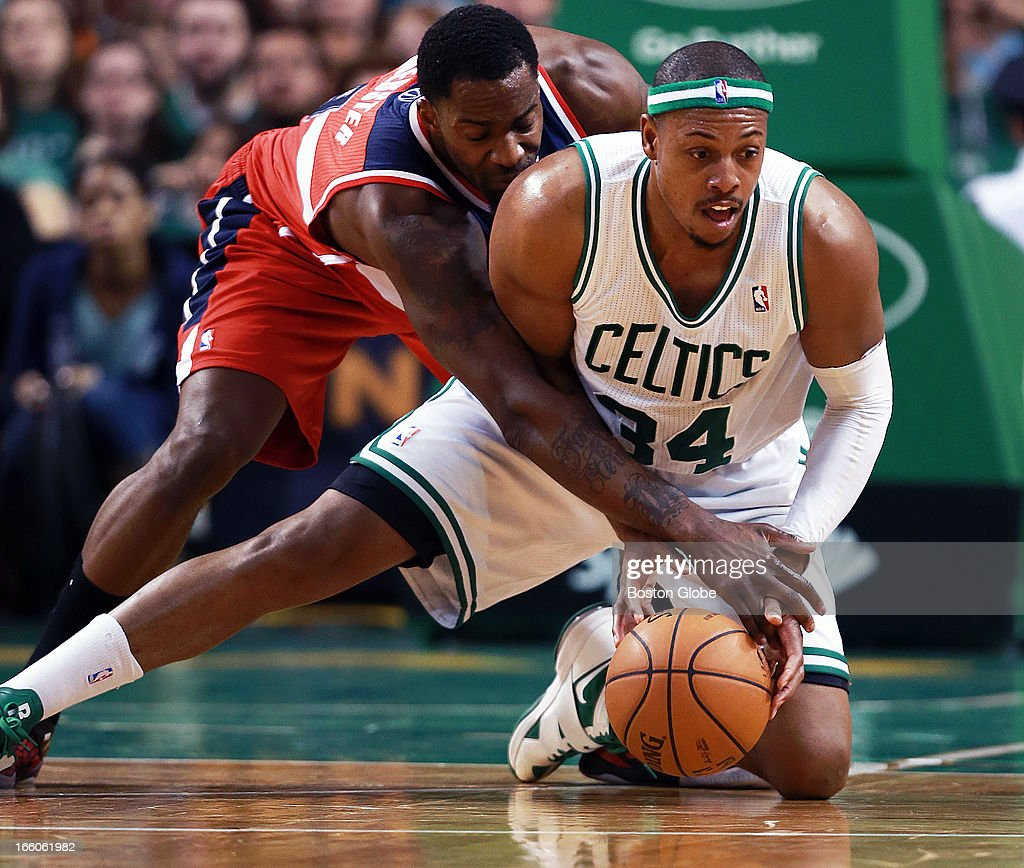 The Celtics Paul Pierce (#34) won this second half loose ball battle with the Wizards Martell Webster, and got off a pass to a teammate. The Boston Celtics hosted the Washington Wizards in an NBA regular season game at TD Garden.
