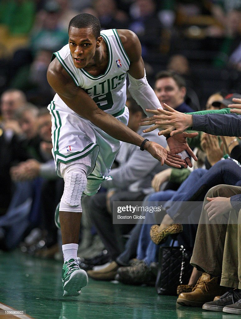 The Celtics' Rajon Rondo capped off his triple double by hitting a shot late in the game to put Boston ahead 96-85, and as he headed back upcourt, he slapped hands with fans in the front row seats. The Boston Celtics hosted the Charlotte Bobcats in a regular season NBA game at TD Garden.