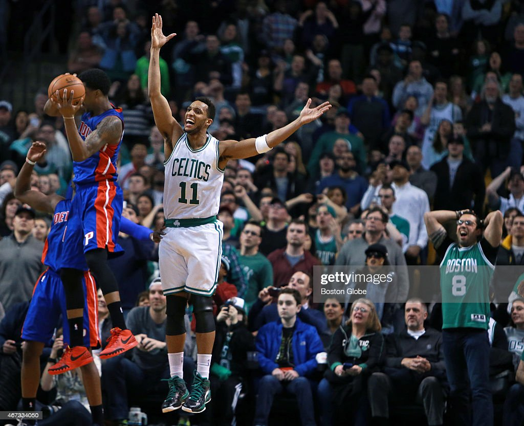 The Celtics were tied with the Pistons with 17 seconds left in regulation with the ball, but they couldn't score even as Boston's <a gi-track='captionPersonalityLinkClicked' href=/galleries/search?phrase=Evan+Turner&family=editorial&specificpeople=4665764 ng-click='$event.stopPropagation()'>Evan Turner</a> (#11) tried to go to the hoop, but somehow lost the ball to Detroits's <a gi-track='captionPersonalityLinkClicked' href=/galleries/search?phrase=Kentavious+Caldwell-Pope&family=editorial&specificpeople=7621166 ng-click='$event.stopPropagation()'>Kentavious Caldwell-Pope</a>, as Turner called for a foul and a fan at right had his own reaction. The game went to overtime, where the Pistons won easily. The Boston Celtics hosted the Detroit Pistons in a regular season NBA game at the TD Garden.