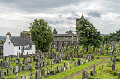 View of the cemetery behind the Church of the Holy Rude, in Stirling, Scotland, United Kingdom. This medieval building, adjacent to Stirling Castle, is the parish church of the city of Stirling in cen