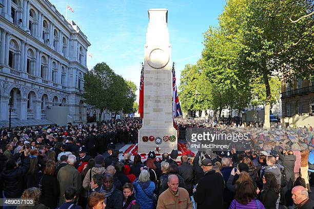 The Cenotaph surrounded by crowds after Remembrance Sunday service in 2013