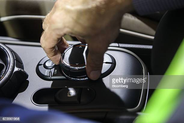 The center console control of the Bayerische Motoren Werke AG MINI Countryman compact sports utility vehicle is demonstrated during an event in Los...