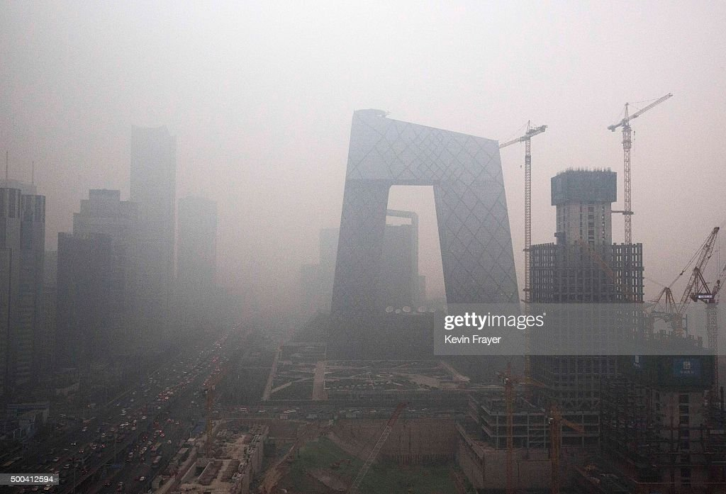 The Central Business District is seen in heavy smog on December 8 2015 in Beijing China The Beijing government issued a 'red alert' for the first...