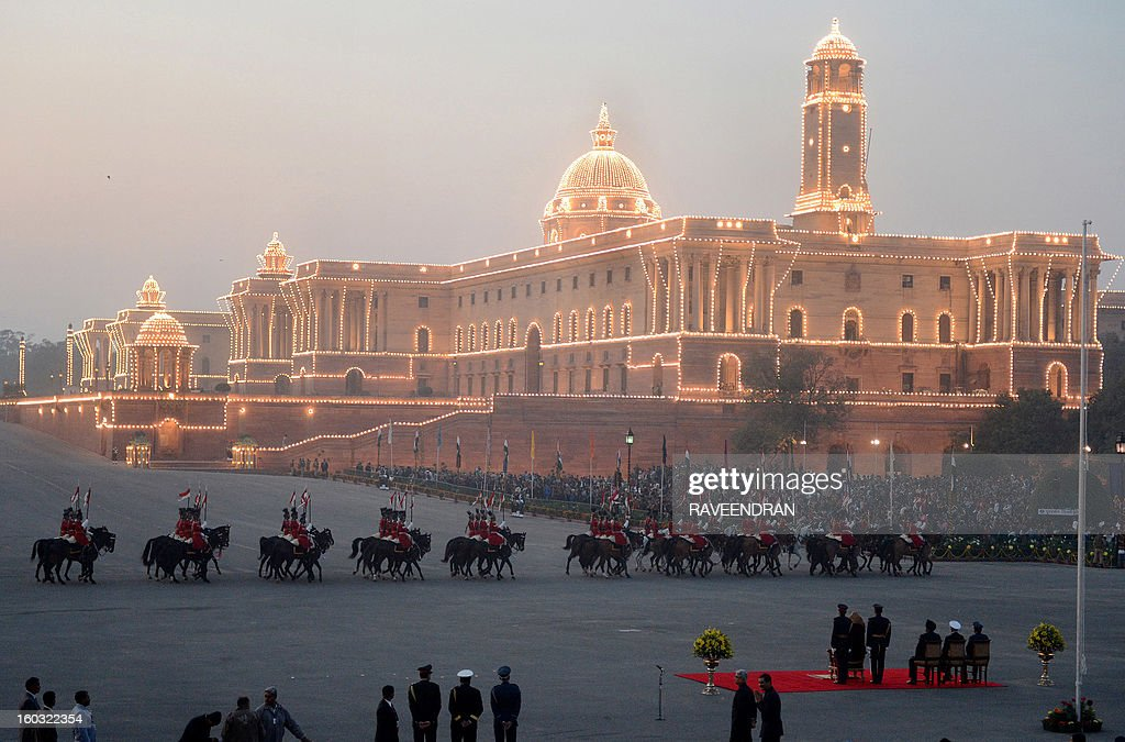 The Central Secretariat and Parliament buildings are illuminated during the Beating Retreat Ceremony at Vijay Chowk in New Delhi on January 29, 2013. The ceremony is a culmination of Republic Day celebrations and dates back to the days when troops disengaged themselves from battle at sunset.