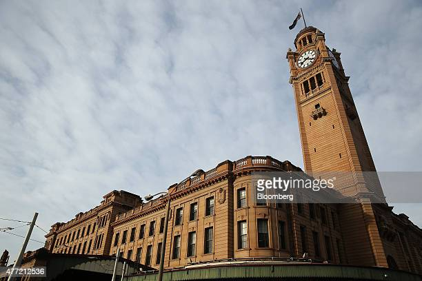 The Central Station building and clock tower stand in Sydney Australia on Tuesday June 9 2015 Australian wages fell in the first quarter for the...