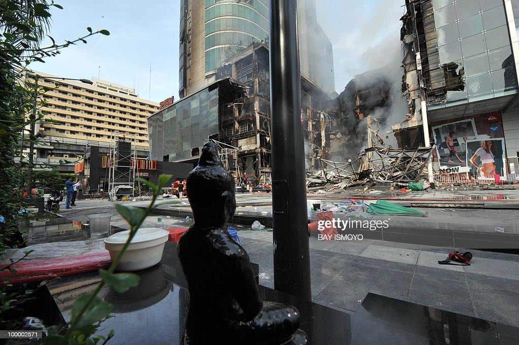 The Central world shopping mall continues to smoulder after it was set ablaze by angry protesters the day before in downtown Bangkok on May 20, 2010. Plumes of smoke hung overhead as Bangkok emerged from an curfew aimed at quelling mayhem unleashed by enraged anti-government protesters targeted in an army offensive on May 2010.