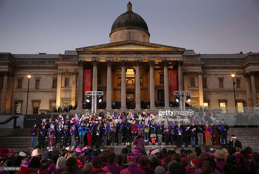 The Centre for Young Musicians Concert Choir sings at a Christmas carol concert held in Trafalgar Square on December 8, 2012 in London, England. The concert is being held to thank the London Olympic 2012 volunteers. London Mayor Boris Johnson thanked the 8000 which he said 'proved to be the beating heart of the Games'.