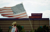 The Century 16 movie theater sits in the background past a small American flag July 29 2012 in Aurora Colorado Twentyfouryearold James Holmes is...