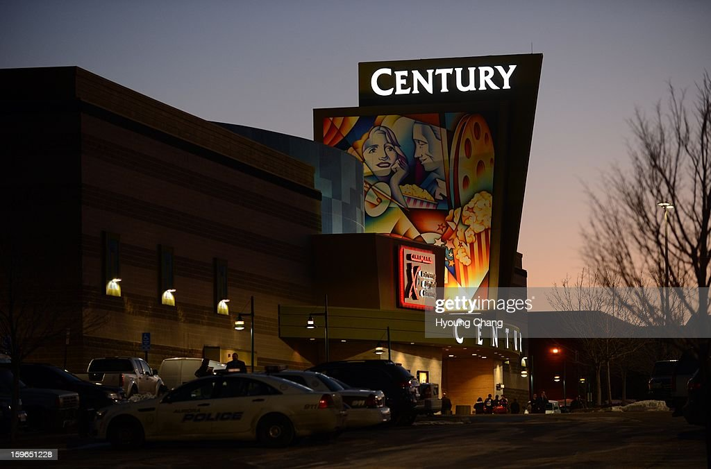 The Century Aurora movie theater is lighted up for the reopening. The movie theater where a gunman killed 12 people and wounded dozens of others reopened with a private ceremony for victims, first responders and officials.