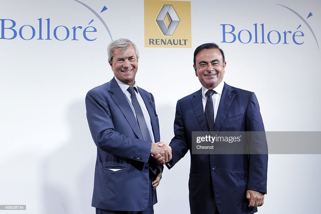 The CEO of French carmaker Renault, <a gi-track='captionPersonalityLinkClicked' href=/galleries/search?phrase=Carlos+Ghosn&family=editorial&specificpeople=215025 ng-click='$event.stopPropagation()'>Carlos Ghosn</a> (R), shakes hands with French industrial group Bollore's head Vincent Bollore at the end of a press conference at the Atelier Renault on September 9, 2014, in Paris, France. <a gi-track='captionPersonalityLinkClicked' href=/galleries/search?phrase=Carlos+Ghosn&family=editorial&specificpeople=215025 ng-click='$event.stopPropagation()'>Carlos Ghosn</a> announced that Renault would manufacture in the northwestern French city of Dieppe the Bollore's Bluecar electric vehicle.