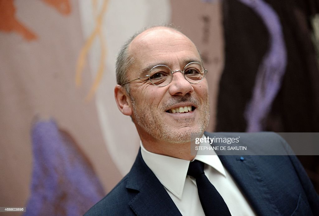 The CEO of French telecommunications operator Orange Stephane Richard poses prior to his hearing in front of a parliamentary commission on April 7...