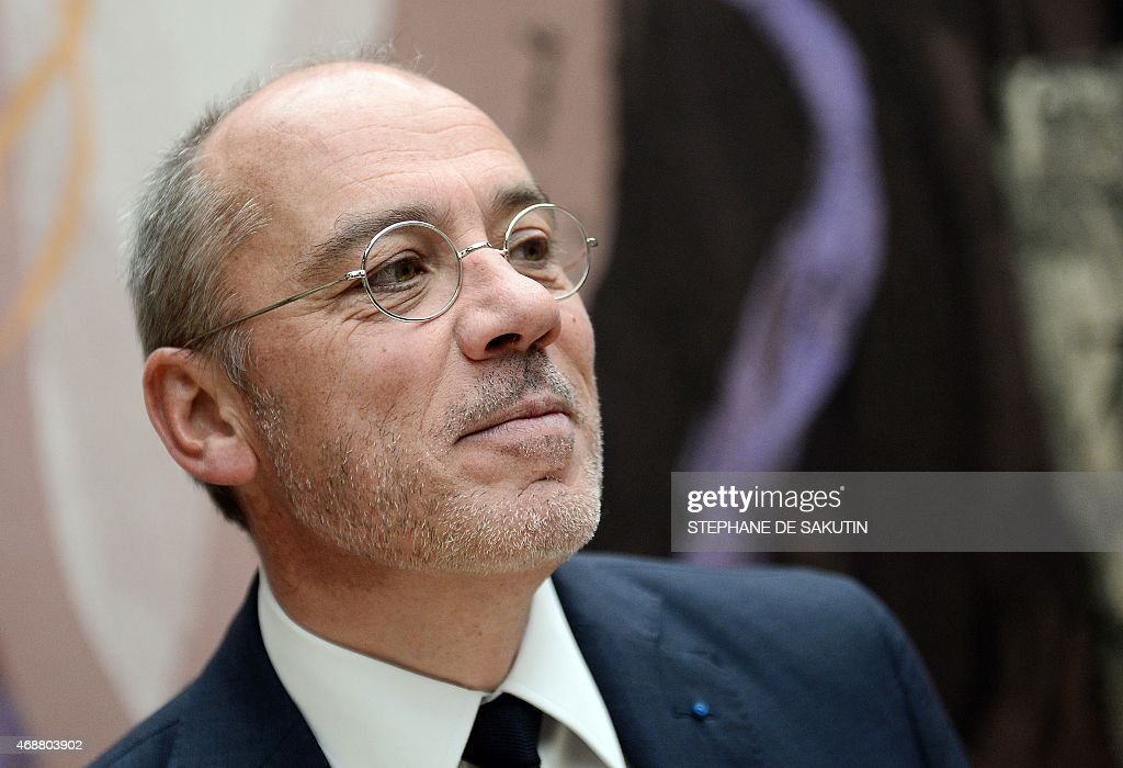 The CEO of French telecommunications operator Orange, Stephane Richard poses prior to his hearing in front of a parliamentary commission on April 7, 2015 at the National Assembly in Paris. AFP PHOTO / STEPHANE DE SAKUTIN