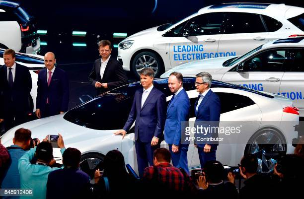 The CEO of German car maker BMW Harald Krueger poses in front of a car during a show at the stand of BMW at the Frankfurt Motor Show IAA in Frankfurt...