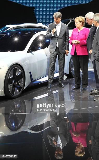 The CEO of German car maker BMW Harald Krueger talks with German Chancellor Angela Merkel Hesse's State Premier Volker Bouffier and Frankfurt's mayor...