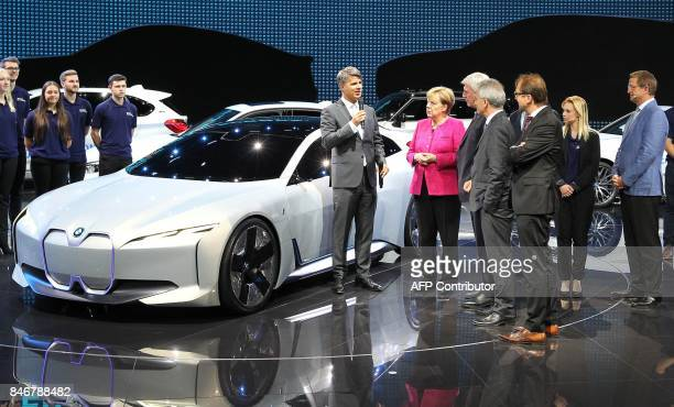 The CEO of German car maker BMW Harald Krueger talks with German Chancellor Angela Merkel Hesse's State Premier Volker Bouffier Frankfurt's mayor...