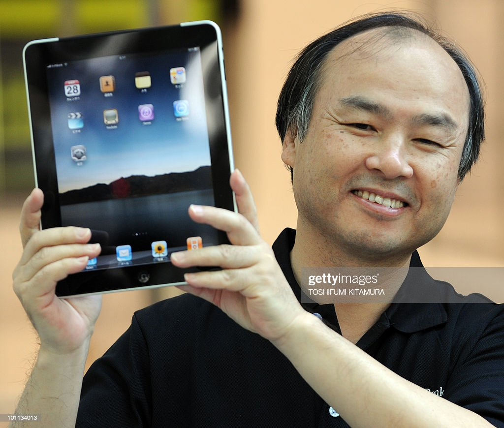 The CEO of Japanese internet service provider Softbank, Apple's exclusive partner in Japan, Masayoshi Son, holds an Apple iPad as they start to go on sale at the Softbank shop in central Tokyo on May 28, 2010. Apple's much-hyped iPad went on sale in a swathe of countries from Australia and Japan to Europe at the start of a global rollout tipped to change the face of computing.
