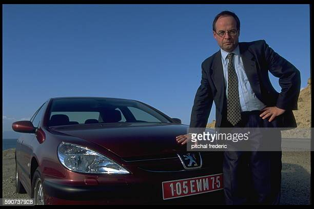 The CEO of Peugeot with the company's new model