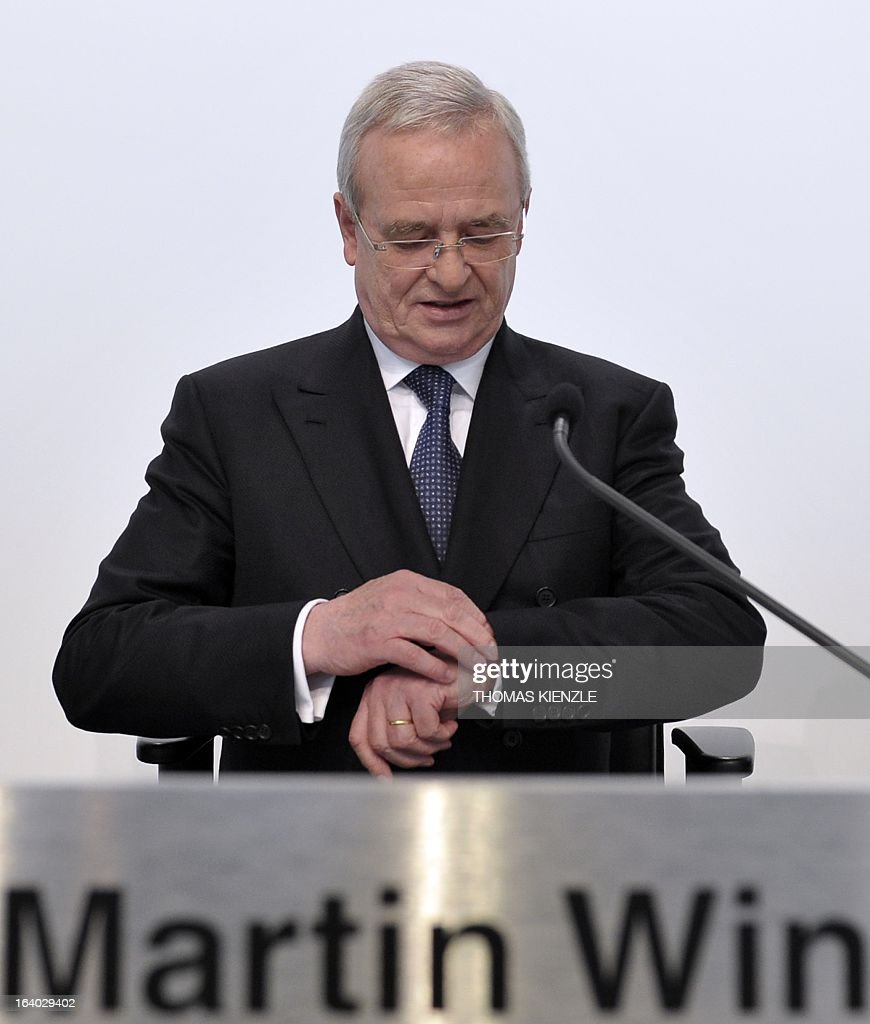 The CEO of Porsche Automobil Holding SE Martin Winterkorn checks his watch during the annual balance press conference of the Porsche Automobil Holding SE in Stuttgart, southern Germany, on March 19, 2013.