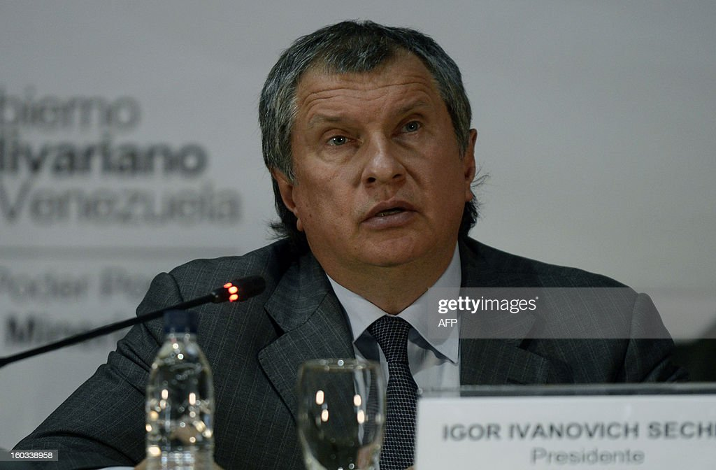 The CEO of Russian state-owned oil company ROSNEFT, Igor Ivanovich Sechin speaks during a meeting with Venezuelan Minister of Oil and Mining and president of state-owned oil company PDVSA Rafael Ramirez (not in frame), to evaluate the development of joint projects in the area of energy and hydrocarbons, in Caracas on January 29, 2013. AFP PHOTO/ Leo RAMIREZ
