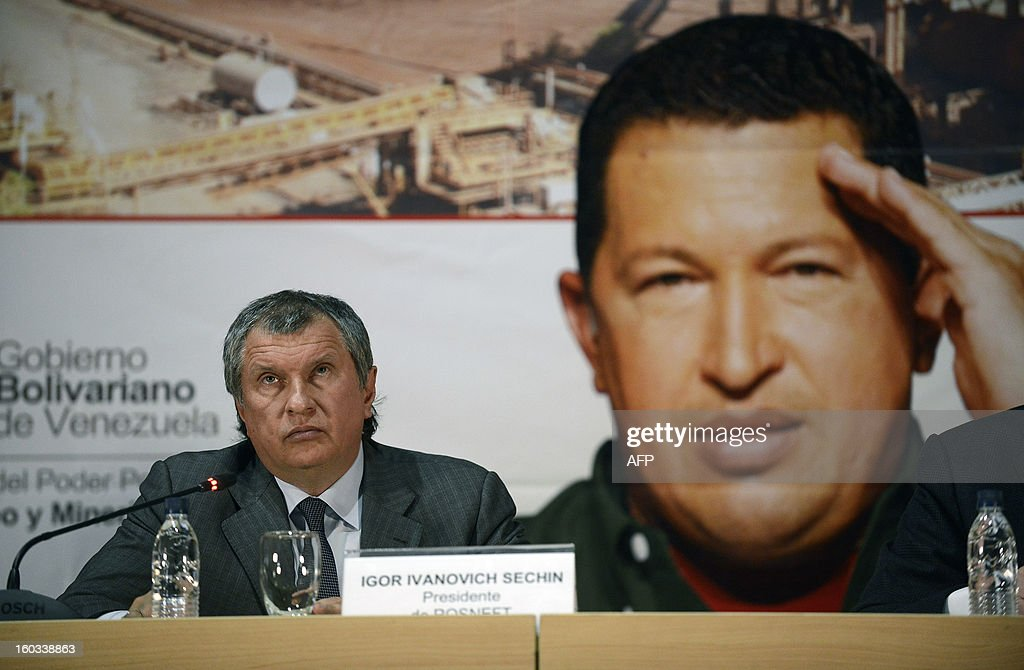 The CEO of Russian state-owned oil company ROSNEFT, Igor Ivanovich Sechin listens to the speech by Venezuelan Minister of Oil and Mining and president of state-owned oil company PDVSA Rafael Ramirez (not in frame) during a meeting to evaluate the development of joint projects in the area of energy and hydrocarbons, in Caracas on January 29, 2013. AFP PHOTO/ Leo RAMIREZ