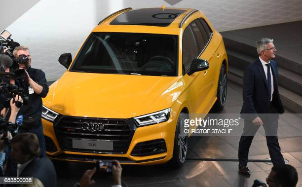 The CEO of the German car producer Audi AG Rupert Stadler walks beside a Audi car ahead the annual press conference in Ingolstadt southern Germany on...