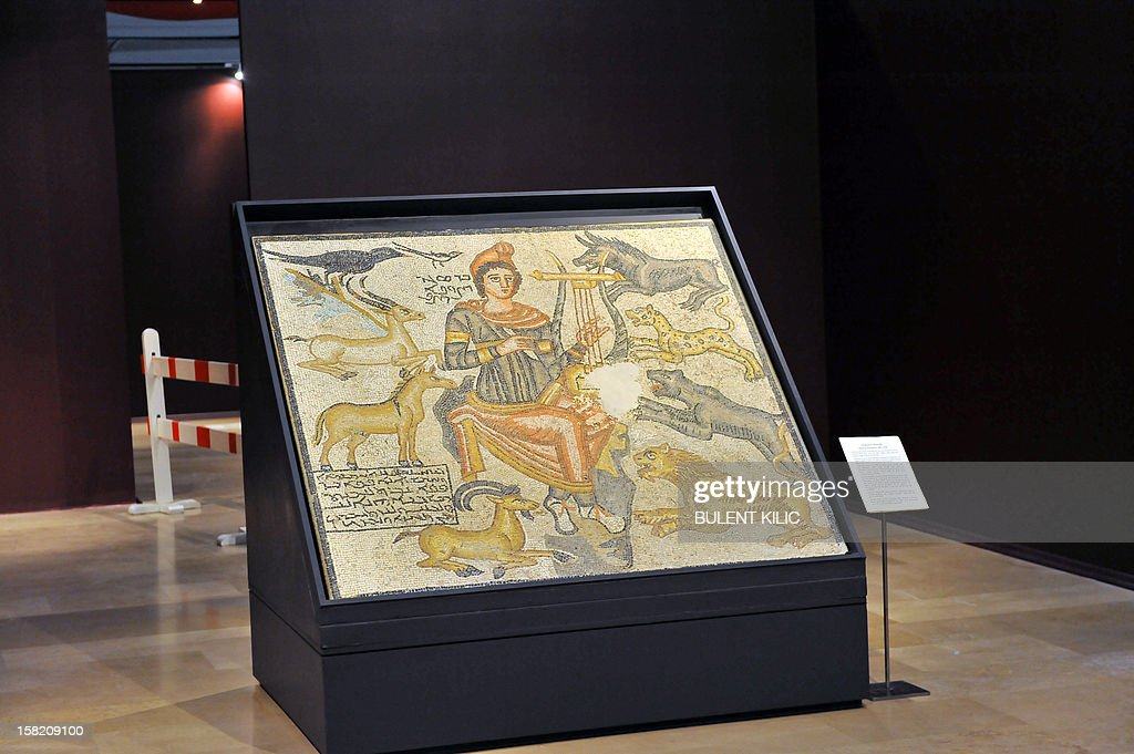 The ceramic mosaic 'Orpheus' is on displayed at the Istanbul Archaeology Museum on December 11, 2012. Turkish Culture and Tourism Minister Ertugrul Gunay introduced a ceramic mosaic from the mythic poet Orpheus that was brought back to Turkey from the Dallas Museum of Art and unveiled to the media at a ceremony in Istanbul on December 8. The Dallas Museum of Art returned the Orpheus Mosaic to Turkey after learning the piece was likely looted from an archaeological site in Turkey following a memorandum of understanding signed between Turkish officials and the Dallas Museum of Art.