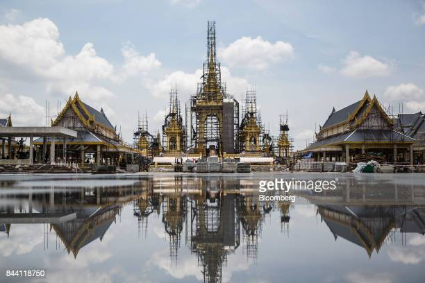 The ceremonial ground for King Bhumibol Adulyadej's cremation sits reflected in a puddle at Sanam Luang park in Bangkok Thailand on Friday Sept 8...