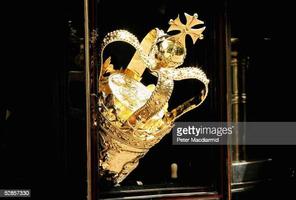The ceremonial Mace is seen protuding from a carraige window as it travels to The House of Lords for the state opening of Parliament on May 17 2005...