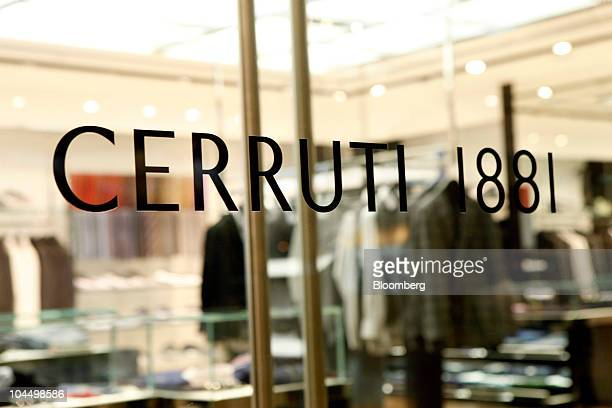 The Cerruti 1881 SAS logo is displayed on a window of a branch of Cerruti 1881 SAS in Hong Kong China on Monday Sept 27 2010 Cerruti 1881 SAS is an...