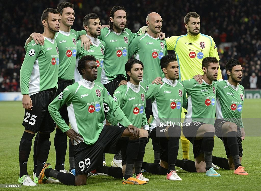 The CFR Cluj-Napoca team line up before the UEFA Champions League group H football match between Manchester United and CFR Cluj-Napoca at Old Trafford in Manchester, north-west England, on December 5, 2012.
