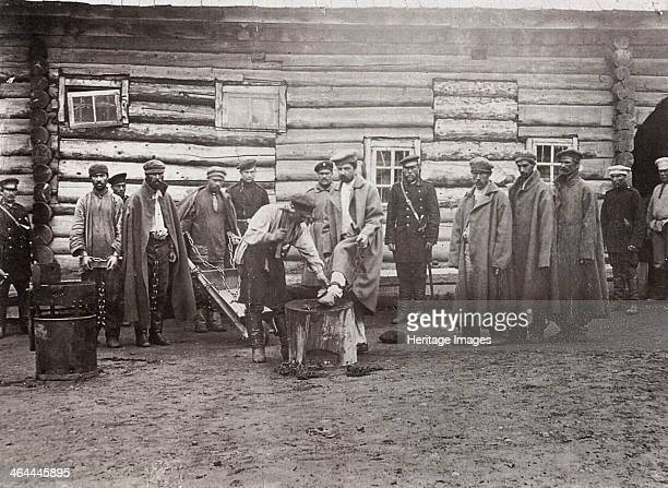 The chaining of prisoners Sakhalin Russia 1890s A large island off the Pacific coast of Siberia Sakhalin became the site of prison labour camps known...