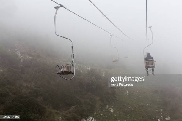The chair lift Monte Solaro in a foggy day, Anacapri, Capri Island, Italy
