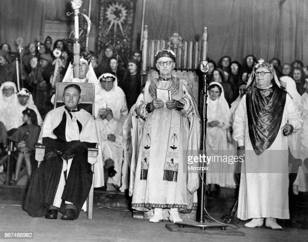 The chaired bard T Llew Jones of Llandysul is seated at the chairing ceremony at the Eisteddfod Ebbw Vale 8th August 1958