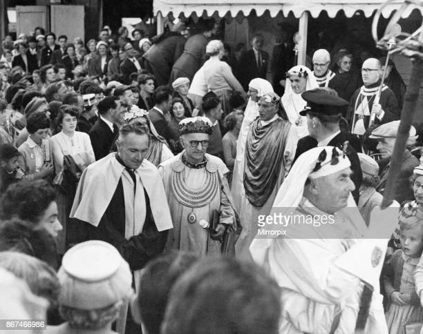 The chaired bard T Llew Jones of Llandysul leaves the pavilion accompanied by the Archdruid after the chairing ceremony The Eisteddfod Ebbw Vale 8th...