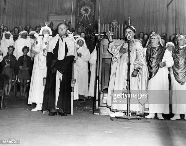 The chaired bard T Llew Jones of Llandysul stands while the sword of peace ceremony is carried out The Eisteddfod Ebbw Vale 8th August 1958