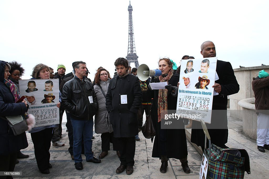 The chairman of a support committee for French hostage Daniel Larribe, Kant (R), takes part on March 16, 2013 in a protest in Paris to show support for the four French hostages kidnapped by Al-Qaeda in the Islamic Maghreb (AQMI) on September 16, 2010 in Niger and held in Mali. THOMAS SAMSON AFP PHOTO