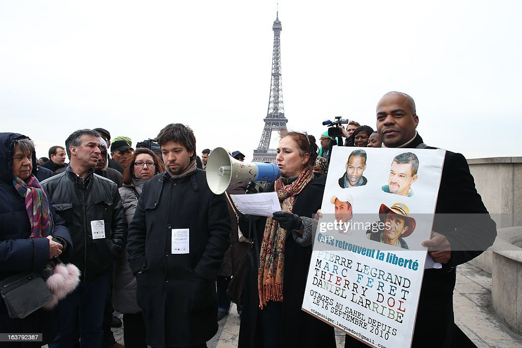The chairman of a support committee for French hostage Daniel Larribe, Kant (R), takes part on March 16, 2013 in a protest in Paris to show support for the four French hostages kidnapped by Al-Qaeda in the Islamic Maghreb (AQMI) on September 16, 2010 in Niger and held in Mali. THOMAS