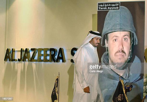 The Chairman of Al Jazeera Sheikh Mamad Al Thani arrives to make a statement during a news conference at their headquarters to protest the death of...