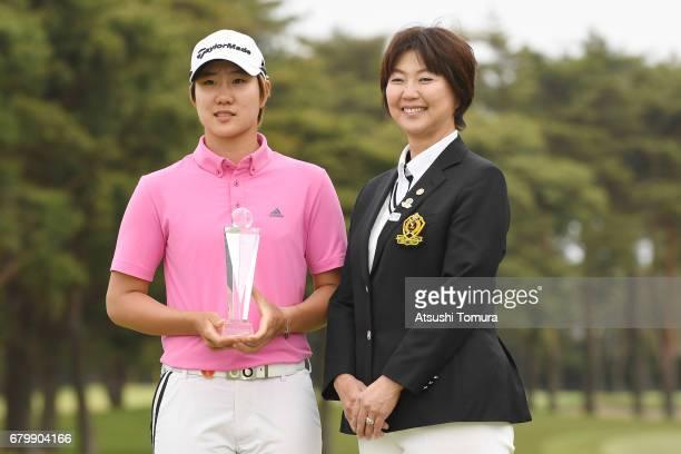 The chairman of LPGA Japan Hiromi kobayashi and Eun Jeong Seong of South Korea pose with the trophy after the World Ladies Championship Salonpas Cup...