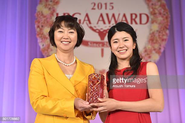 The chairman of LPGA Japan Hiromi kobayashi and Kotone Hori of Japan pose with the trophy during the LPGA Award 2015 on December 17 2015 in Tokyo...
