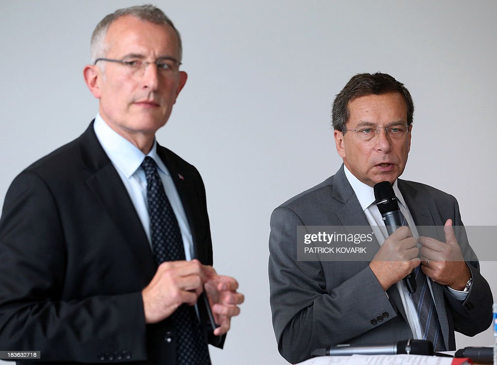 The chairman of Reseau Ferre de France (RFF) Jacques Rapoport (R) speaks on October 8, 2013 next to the chairman of the state-owned French rail company SNCF, Guillaume Pepy (L), in the Paris suburb of La Plaine Saint-Denis as they present a maintenance plan for the network following the July 12 derailment in the Paris suburb of Bretigny-sur-Orge that left six dead. RFF owns and maintains the French national railway network.