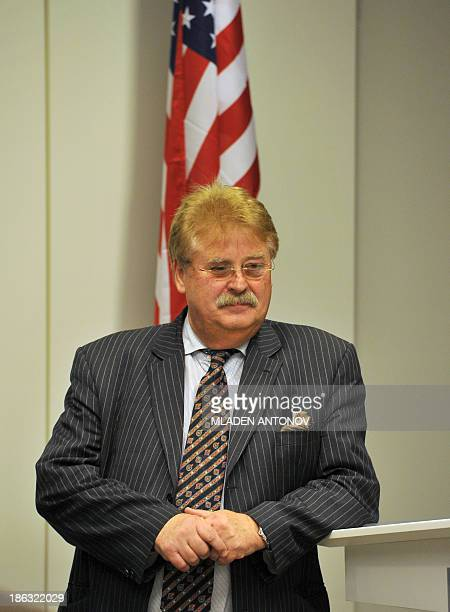 The Chairman of the European Parliament's Committee on Foreign Affairs Germany's Elmar Brok listens to a question during a press conference at the...