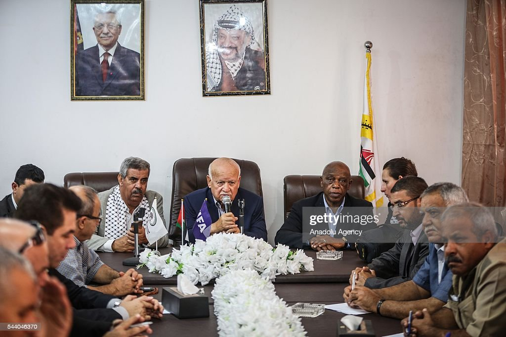The chairman of the FIFA Monitoring Committee Israel-Palestine, Tokyo Sexwale (C-R) holds a press confrence after his visits the Palestinian Football Association (PFA) headquarters building at Beit Lahia in distirct of Gaza City, Gaza on July 01, 2016.