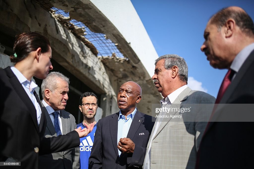 The chairman of the FIFA Monitoring Committee Israel-Palestine, Tokyo Sexwale (3rd R) visits the Palestinian Football Association (PFA) headquarters building at Beit Lahia in distirct of Gaza City, Gaza on July 01, 2016.
