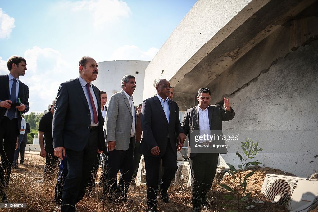 The chairman of the FIFA Monitoring Committee Israel-Palestine, Tokyo Sexwale (2nd R) visits the Palestinian Football Association (PFA) headquarters building at Beit Lahia in distirct of Gaza City, Gaza on July 01, 2016.