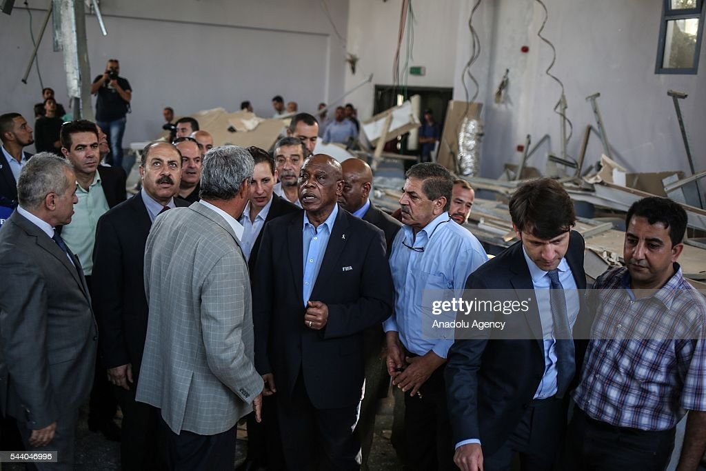 The chairman of the FIFA Monitoring Committee Israel-Palestine, Tokyo Sexwale (4th R) visits the Palestinian Football Association (PFA) headquarters building at Beit Lahia in distirct of Gaza City, Gaza on July 01, 2016.