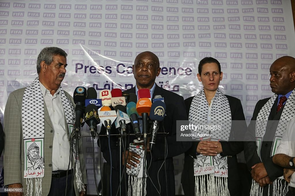 The chairman of the FIFA Monitoring Committee Israel-Palestine, Tokyo Sexwale (2nd L) holds a press conference after his visits the Palestinian Football Association (PFA) headquarters building at Beit Lahia in distirct of Gaza City, Gaza on July 01, 2016.
