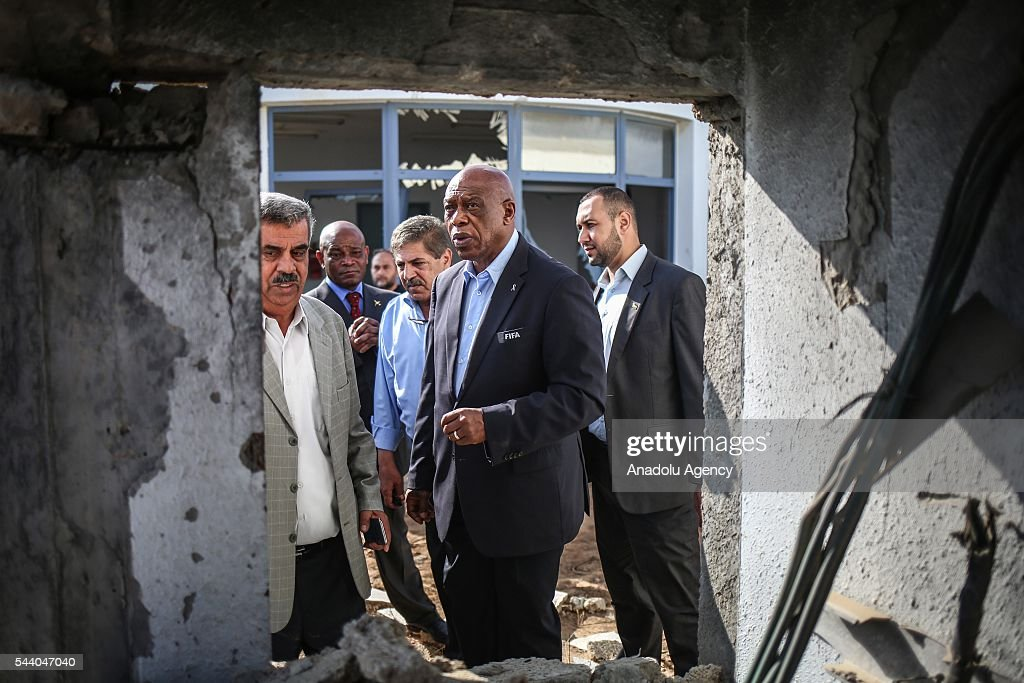 The chairman of the FIFA Monitoring Committee Israel-Palestine, Tokyo Sexwale (C) visits the Palestinian Football Association (PFA) headquarters building at Beit Lahia in distirct of Gaza City, Gaza on July 01, 2016.