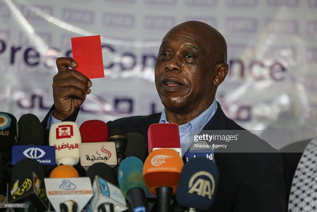 The chairman of the FIFA Monitoring Committee Israel-Palestine, Tokyo Sexwale shows a red card against border violation by Israeli soldiers during a press conference after his visits the Palestinian Football Association (PFA) headquarters building at Beit Lahia in distirct of Gaza City, Gaza on July 01, 2016.