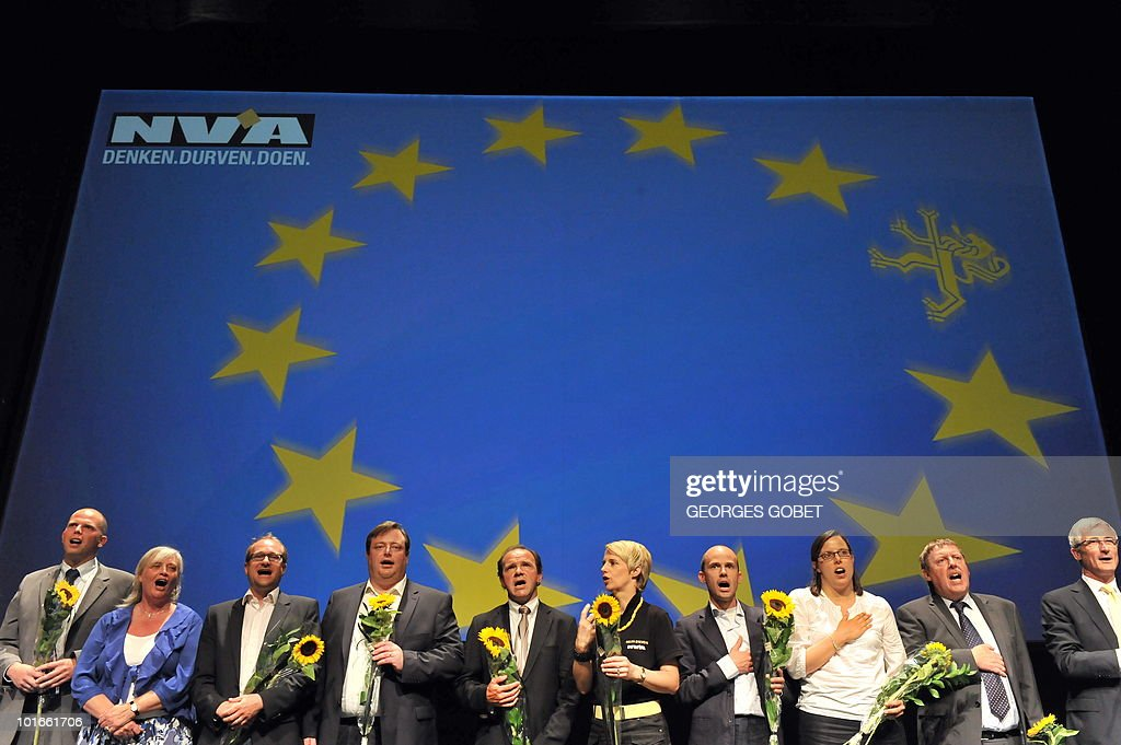 The chairman of the Flemish nationalist party N-VA, Bart De Wever (4th L), and party candidates sing the Flemish anthem on June 6, 2010 at an election meeting in Gent. Belgium's parliament dissolved itself on June 3, paving the way for general elections made inevitable by the collapse of the ruling coalition last month. The elections are set for June 13.